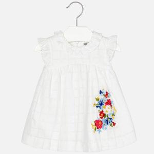 Sukienka z falbankami i kwiatami